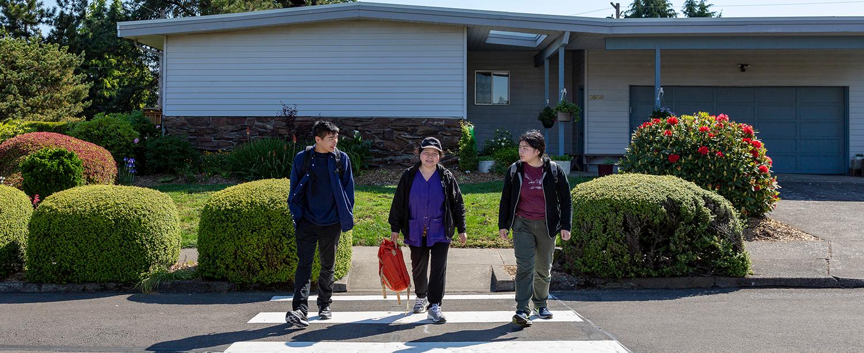 family in crosswalk